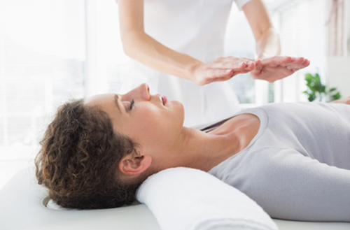 Woman having Reiki treatment in Kelowna, Canada